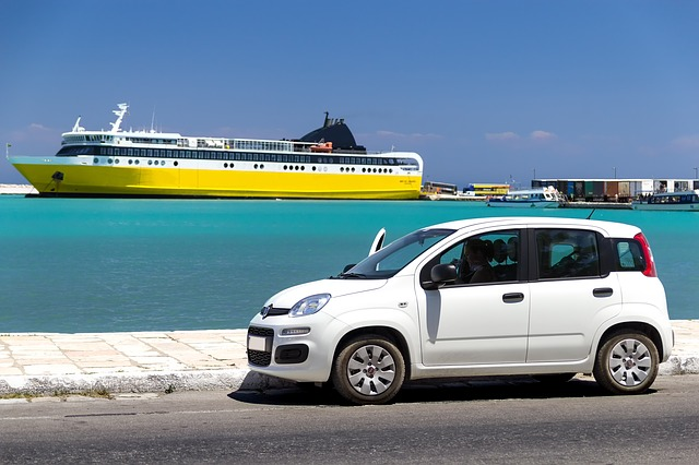White rental car at the habour, yellow ferry in the back
