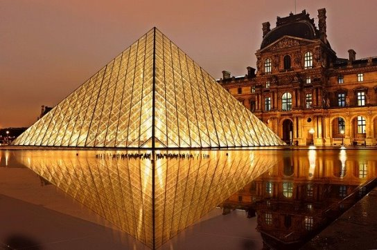Glass pyramid in courtyard of Louvre (Paris, France) by night, illuminated
