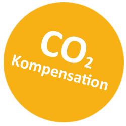 Runder, orangefarbener Kreis mit weißer Aufschrift CO2 Kompensation